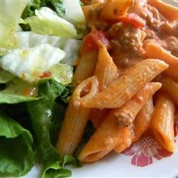Fast Creamy Tomato Penne Recipe - Great quick dish for working parents or anyone who is pressed for time. Ground pork, spaghetti sauce and sour cream mixed with penne pasta. It's a family favorite.