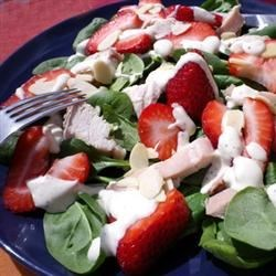 Chicken Strawberry Spinach Salad with Ginger-Lime Dressing Recipe - Chicken and strawberries are served over a bed of spinach, sprinkled with almonds and served with a creamy lime dressing.