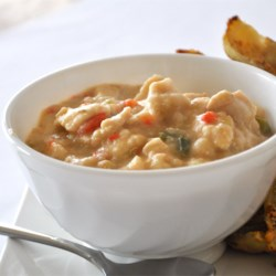 White Chili II Recipe - Flecks of jalapeno and red and yellow bell peppers accent this hot, zesty chicken and white bean chili.  Not for the timid.