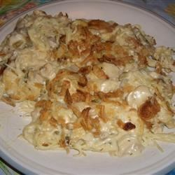 Easy Turkey Tetrazzini Recipe - An easy, quick turkey dish that turns precooked turkey into a family favorite. Cooked turkey is combined with mushrooms, celery soup and sour cream, then baked in a dish with noodles.