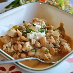 Cha Cha's White Chicken Chili Recipe and Video - Delicious white bean chili. Cha Cha says: 'It's kinda spicy, so watch out!' Substitute mild green chiles for the jalapenos if you're scared! Use more chicken and cheese as desired.