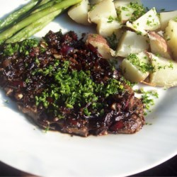 Flat Iron Steak with Balsamic Reduction Recipe - Pepper crusted flat iron steaks are pan seared then drizzled with a sweet and savory syrup. This dish is simple, impressive, and delicious!