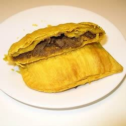 Jamaican Patties Recipe - These are delicious meat turnovers made with delicately seasoned ground beef. You can use a pie crust from a mix, or make your own. These are great to freeze, and bake when you want a quick snack.