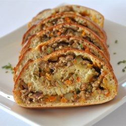 Hidden Treasures Ranch Pockets Recipe - This delicious and easy recipe is a great way to get your family to eat more veggies. The filling contains zucchini, carrots, cabbage, red pepper, onions, and garlic, yet still tastes so yummy that even the pickiest eaters gobble them up!
