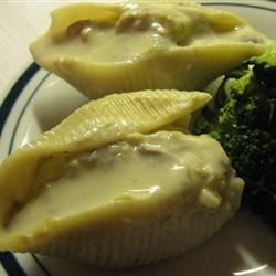 Chicken Stuffed Shells Recipe - These chicken stuffed shells are easy and very yummy. Plus they heat up as leftovers really well! My family loves them!!! I usually cook a 3-4 pound chicken and use it for the shells and a chicken salad.