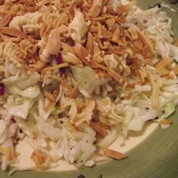 Fugi Salad Recipe - This is an unusual cabbage salad with crunchy ingredients like toasted nuts, sesame seeds and Ramen noodles. It 's dressed with sweetened vinegar and oil, tossed and served.