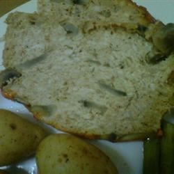 Chicken Mushroom Meatloaf Recipe - Home-minced chicken breast and thigh meat forms the foundation of this light chicken loaf, flavored with mushrooms and fresh herbs.