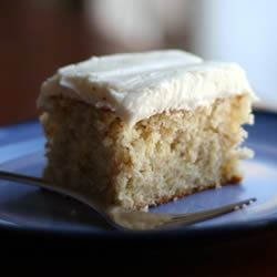 Banana Cake II Recipe - My family loves this cake.  Frost with a cream cheese frosting with one ripe banana added and confectioners' sugar sprinkled over the top.