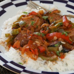 Best Ever Sausage with Peppers, Onions, and Beer! Recipe - This is an excellent recipe I came up with one day. Italian sausage is simmered in beer with bell peppers and red onions.
