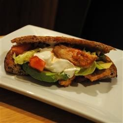 Pita Chicken Recipe - Cayenne, salsa, onion and garlic punctuate this Tex-Mex pita sandwich stuffed with seasoned chicken, tomato, avocado, sour cream and lettuce.