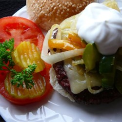Open-Face Swiss Burger Recipe - This is a unique open-face burger topped with Swiss cheese, sauteed onions, mushrooms, bell peppers, and sour cream. Great with French fries.