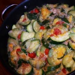 Skillet Zucchini Recipe - Zucchini is sauteed with onion, tomatoes, bacon, and cheese. Great as a side or as a vegetarian main.