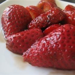Strawberries with Balsamic Vinegar Recipe - This is a gourmet, unique way to serve this fantastic summer fruit! The balsamic vinegar brings out the berries' beautiful color and truly enhances their flavor. Great served with a simple pound cake, over vanilla ice cream, or simply by themselves.