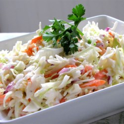 Restaurant-Style Coleslaw I Recipe and Video - This salad has the perfect coleslaw taste. Very, very creamy with a bit of sweet/tartness stirred in. Everything is stirred into one bowl, and then chilled before serving. Makes six generous servings.