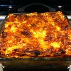 Lasagna Bolognese Recipe - There's nothing especially quick about this richly flavored meat lasagna, with homemade Bolognese sauce flavored with a hint of cinnamon, and an eggy ricotta cheese filling  -- but some things are worth it.