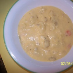 Cheesy Potato Soup II Recipe - Onions and celery sauteed in butter, cooked potatoes and processed cheese are combined in this creamy soup made with processed cheese and thickened with flour.