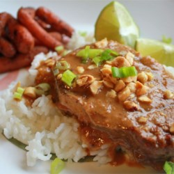 Slow Cooker Thai Peanut Pork Recipe - Thai flavors of peanuts and lime come together easily with pork loin in this simple slow cooker recipe.