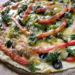 Hummus Pizza Recipe - This pizza uses hummus instead of the usual red sauce. Top with your favorite veggies and cheese.