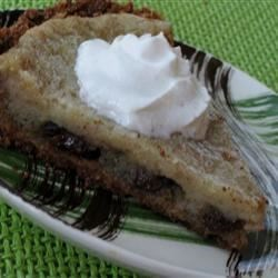 Raisin Sour Cream Pie Recipe - Try this easy to make sour cream and raisin pie in a graham cracker crust. Serve with whipped topping.