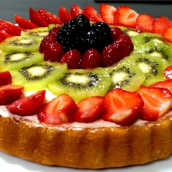 Fresh Fruit Flan Recipe - A beautiful fresh fruit dessert with strawberries, blueberries and kiwi, this is not your regular 'fruit pizza.'  You can substitute other favorite fruits or berries for those in this recipe.
