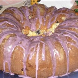 Blueberry Cream Cheese Pound Cake II Recipe - A moist and easy cake made with a cake mix, pudding mix, cream cheese and blueberries. It's baked in a Bundt pan and topped with a pretty blueberry glaze.
