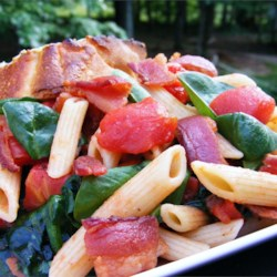 Penne Pasta with Spinach and Bacon Recipe - This is a quick light meal. Wilted spinach, bacon and tomatoes are tossed with penne pasta. Good for any season and will complement anything.