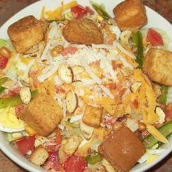 Green Salad Recipe - This is a hearty salad, full of variety. There 's assorted greens, meat or chicken  - your choice, veggies, and a bit of garlic and onion powder to add some zip. Choose your favorite dressing and you have a nice, easy salad that 's a meal in itself.