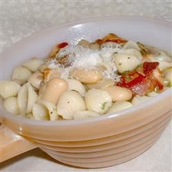 Italian White Bean and Pancetta Soup Recipe - Canned cannellini beans, Italian bacon, and pasta make up this satisfying soup flavored with fresh sage. Garnish with freshly grated Romano or Parmigiano cheese.