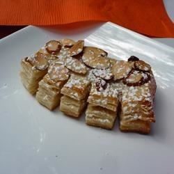 Almond Bear Claws Recipe - These flaky Danish pastries are a time-consuming project, but they're a perfect way to show people how much you love them! I like serving them at special brunches. The puff pastry dough and almond filling can be made ahead of time, and the pastries can be frozen before baking.