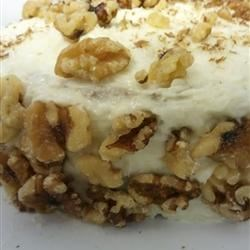 Carrot Cake with a Coconut Cream Cheese Frosting topped with Walnuts