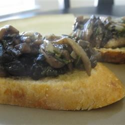 Easy Mushroom Spread Recipe - Your favorite mushrooms sauteed in butter with rosemary, garlic, parsley, vegetable stock and whiskey.  The whiskey is optional but really makes it good!  Serve cold or warm.  Great on a pita with avacado!