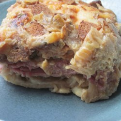 Reuben-Pierogie Casserole Recipe - Corned beef, sauerkraut, and thousand island dressing cover frozen pierogies in this quick and easy dish.