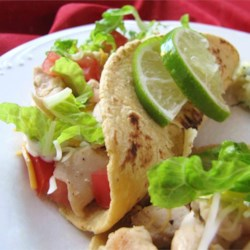 Lime Chicken Soft Tacos Recipe and Video - A lime chicken filling with vinegar, sugar, green onion, oregano and light seasoning makes these soft tacos citrusy-good!