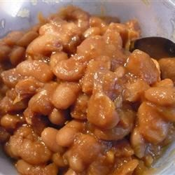 Baked Beans from Scratch Recipe - Navy beans, molasses, and maple syrup combine to make this classic dish at home.