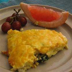American Frittata Recipe - Potatoes, onions, ham and eggs make this a frittata that's sure to please everyone.