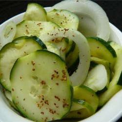 Ceil's Cucumber Slices Recipe - These slices are a zesty mixture of delicious pickled vegetables, perfect for summer.