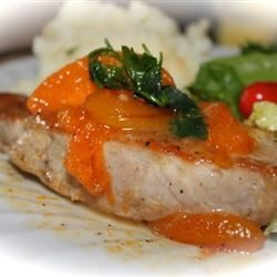 Honey Apricot Pork Chops Recipe - Pork chops are browned and simmered to tenderness with honey and fresh apricots for a lovely spring and early summer treat.