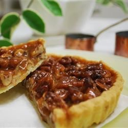 Pecan Pie II Recipe - This is one of my husband's favorite pies.  I can also say that it is mine as well, and my children sure go for this one.  This pie can be baked in small fluted foil pans to make 8 to 10 individual pies.