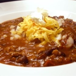 Chris' Chili Recipe - Here's the secret recipe for a chili that has won more than 12 chili contests. It's a steak and bean chili with (sshhh!) cocoa powder and cola, among other things. There's bacon grease, but no bacon.