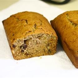 Zucchini Walnut Bread Recipe - Succulent raisins and chewy walnuts enhance this cinnamon-scented zucchini bread.