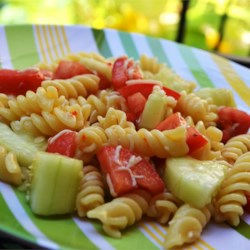 Pasta Salad II Recipe - Cucumbers and olives are tossed with cubes of Monterey Jack cheese and salad seasoning to make the base for this easy pasta salad. Add cooked pasta and toss with Italian dressing. Chill before serving to let the flavors meld.
