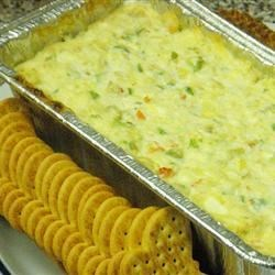 Warm Crab Dip I Recipe - Thick and rich and a hot-appetizer favorite, this crab spread can be thinned with additional white wine.