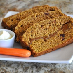 Pumpkin Butter Bread Recipe - Apple juice and a variety of spices join pumpkin butter in this moist, flavorful holiday bread.