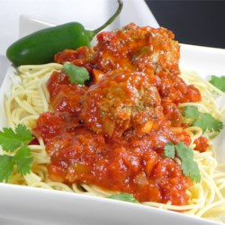 Mexican-Style Spaghetti and Meatballs Recipe - Turkey meatballs are spiced up with several varieties of chile pepper in this tasty, south-of-the-border take on spaghetti and meatballs.