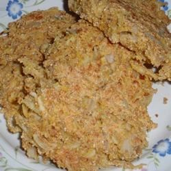Squash Puppies Recipe - Tasty golden brown fritters made from cornmeal and shredded summer squash are a great side dish for your favorite fish, chicken, or grilled meats.