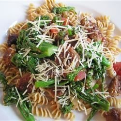 Spicy Sausage Broccoli Rabe Parmesan Recipe - The intense flavor of broccoli rabe combines with the savory taste of hot Italian sausage and tomatoes for a quick but heart sauce served over whole wheat rotini.