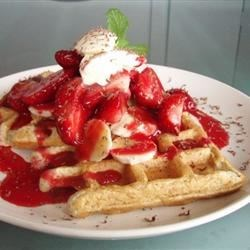 Cornmeal Waffles Recipe - These delicious whole wheat and cornmeal waffles have a light crunchy texture. Serve hot with syrup, or fruit and whipped cream.
