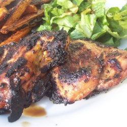 Grilled Caribbean Chicken Breasts Recipe - A spicy orange-ginger soak infuses chicken with a hot and sweet essence.