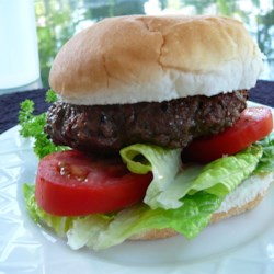 The Juiciest Hamburgers Ever Recipe - Hamburger patties get a big flavor boost from a beer and Worcestershire sauce marinade.