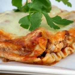 Bob's Awesome Lasagna Recipe - This is a traditional baked lasagna that is a favorite in our family. Ground beef, cottage cheese, and mozzarella make it rich and filling.